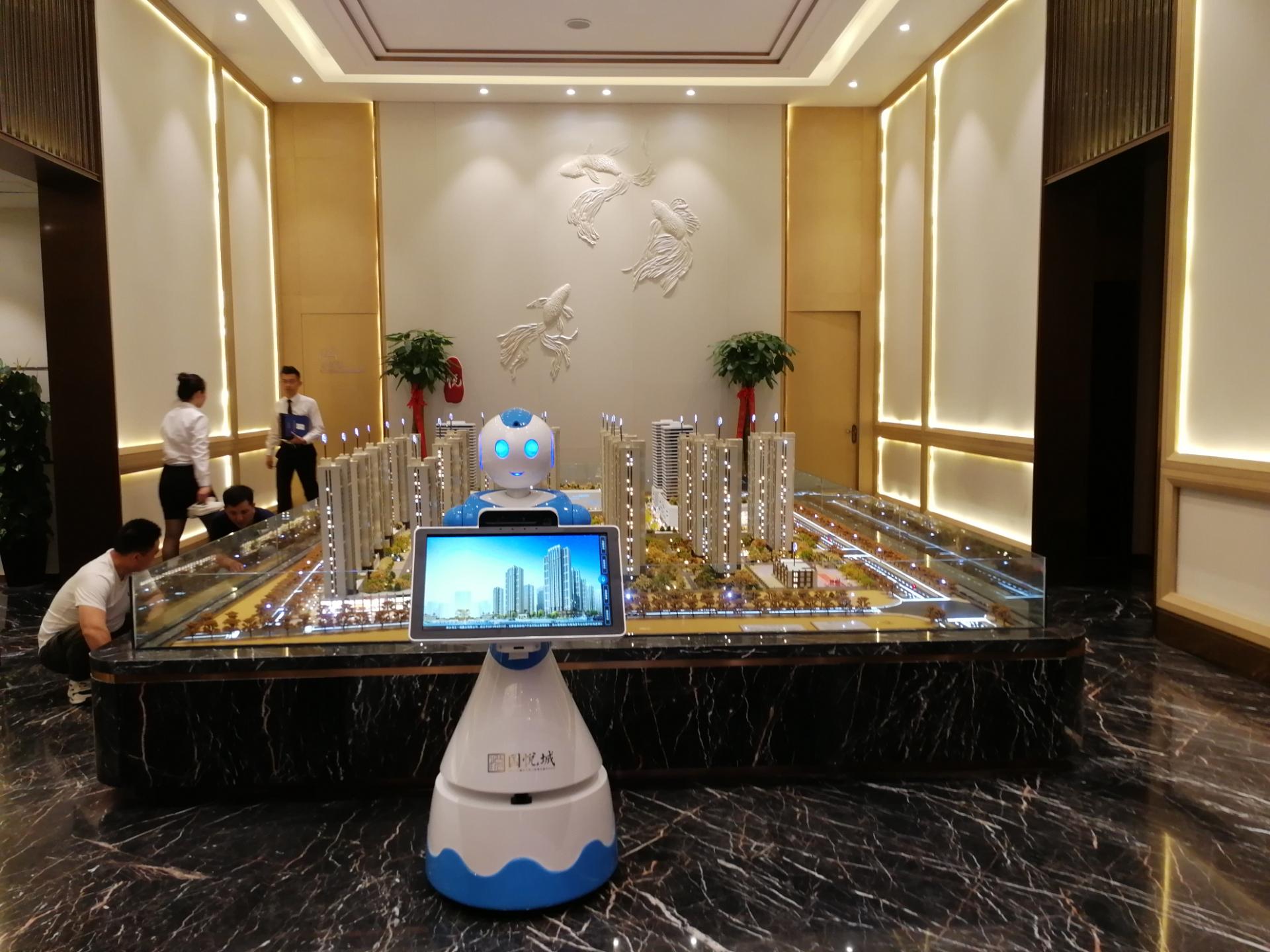 智能机器人楼盘销售机器人频道里,沙盘讲解机器人娃娃正,售楼中心机器人真丑陋,物业机器人